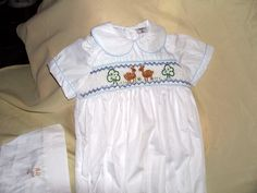 smocked rompers $130 ring 0427820744
