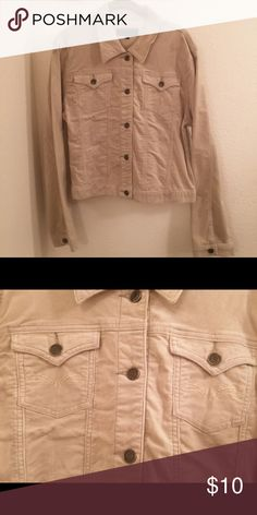 Beige corduroy long sleeve button up jacket Beige corduroy button up jacket with collar. Brass colored buttons, including one on each sleeve. Jacket is short in length, approximately 21 inches, sleeves are approximately 24 inches. There is an embroidered tan colored design on both breast pockets. Picture attached. Junior sizing. NWOT touch down girls Jackets & Coats