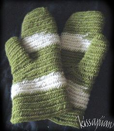 """Nalbound mittens with horizontal stripes: """"Off-white and dyed wool yarn needled into the mittens. Finnish stitch, 2+2 thumb on top."""""""