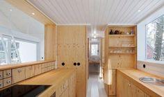 Cocina de cabaña en madera de pino