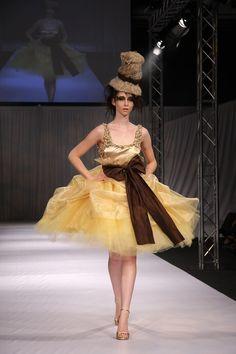 Designer: Rebecca Timson Photographer: Penny Lane  Gold Contemporary Couture Dress
