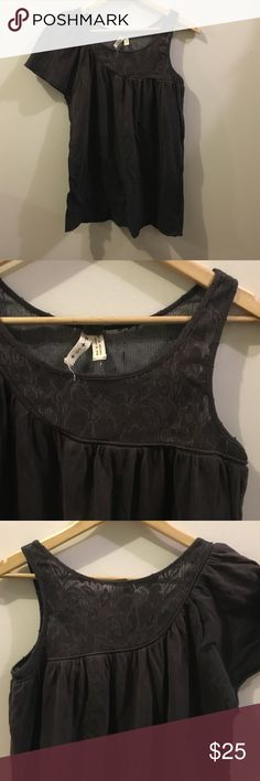 Free People We The Free Asymmetrical Flowy Top Faded black color (almost purplish) (some color fade in areas - part of deconstructed style). Asymmetrical Sleeve. Soft and flowy. 100% Cotton body. Free People Tops Tunics