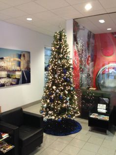 our 9ft tree with blue and silver decorations for jim ellis volkswagon atlanta rental