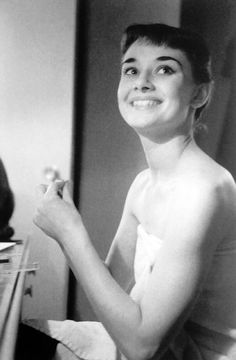 Audrey Hepburn photographed by George Douglas backstage in her dressing room applying her makeup.  She was starring as the title role of Gigi on Broadway in New York, USA, 1952.