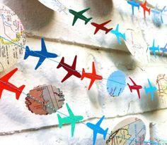 The Bon Voyage Air Plane Garland, Paper Garland, Blue, Orange, Green, Multi colored, Maps. $12,00, via Etsy.
