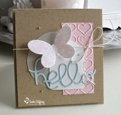 sweet little card!  elements come together so well--embossed panel, circle, twine, diecut, butterfly, pearls!