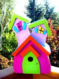 What an awesome handmade bird house!! If I liked birds I would totally get one.. I love the colors!!