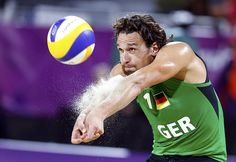 Germany's Jonathan Erdmann digs the ball against Czech Republic's Premysl Kubala and Petr Benes during their men's lucky loser beach volleyball match at Horse Guards Parade during the London 2012 Olympic Games August 2, 2012.