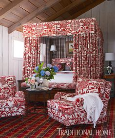 A luxuriously draped canopy bed brings big drama to the petite space. The red Pierre Frey toile repeats on comfy chairs. Traditional Bedroom, Traditional House, Mountain Bedroom, Lounge Chair Cushions, Red Cottage, Big Girl Rooms, Wedding Chairs, Bedroom Accessories, Dream Rooms