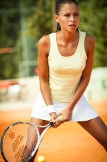 Attractive female tennis player stock photo
