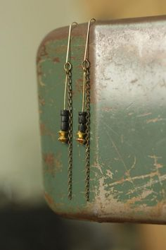 chain earrings with black heishi and brass by acommonthread, $24.00
