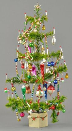 "Hard-to-find small feather tree with candles, fully decorated with ornaments and glass beads. 21"" h. (Exc. Cond.)"