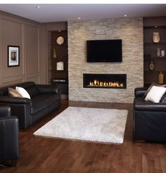 Best idea yet for Basement Fireplace! Do a stone wall, modern fireplace, mounted tv above fireplace and possibly the built-ins. - Decoration for House Tv Above Fireplace, Linear Fireplace, Basement Fireplace, Fireplace Design, Custom Fireplace, Fireplace Stone, Fireplace Ideas, Basement Stairs, Fireplaces With Tv Above