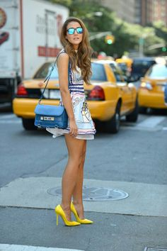 Get out of the middle of the street before those hot legs in yellow pumps are hit by a car