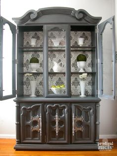 Open Display of Wallpapered China Cabinet by Prodigal Pieces   www.prodigalpieces.com