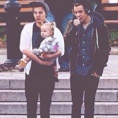 The dads Harry and Louis taking their daughter down to the park...MY HEART