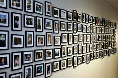 This is a photo wall in the conference room of large company.  It's pictures of their employees having fun.  I think it's a lovely way to display and foster the sense of community this company obviously has.