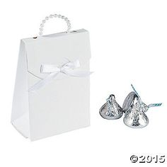 These elegant favor boxes feature a 3/4 handle made of plastic pearls and a darling white ribbon accent. Paper. (2 dozen per unit) 2 1/2 x 1 1/2 x 3 1/2 ...
