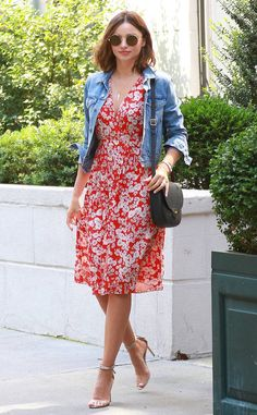 Miranda Kerr from The Big Picture: Today's Hot Photos  Floral frock! The model looks pretty in her summery dress, heels and jean jacket in New York City.