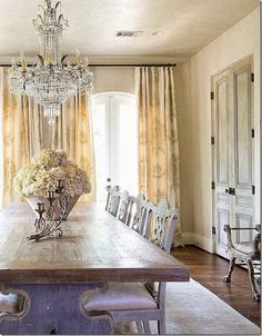 lovely chandelier, farmhouse table, and soft window treatments ♡