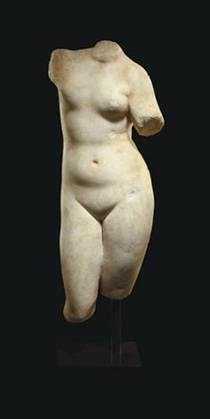 A ROMAN MARBLE TORSO OF VENUS CIRCA 1ST CENTURY B.C.-1ST CENTURY A.D.