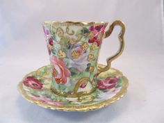 Nippon Cup and Saucer with Flowers and Lots of Gold.