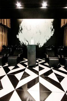 The decor of this modern elegant beauty salon creates a sense of luxury through the use of black and white tile patterns. The interior design is sophisticated with its use of bronze sheer curtains to create private treatment rooms. Other decor ideas are the use of sleek styling stations giving a boutique hair salon ambience. | #sink | #washbasin | #shampoo |