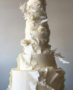 Yep, she was a biggie... #whiteonwhite #weddingcake #tornpapereffect #sanfrancisco #cakeart #handmade #sugarflowers #sugarleaves #delicate #ivory