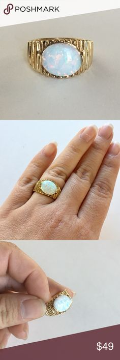 Opal gold silver ring vintage style A beautiful ring with an Opal stone and Sterling Silver with Gold color plating. Lots of beautiful color in this Opal! This piece is stamped 925 UTC. I had my jeweler look at this and they said it is Sterling with a created Opal and some sort of gold plating. Get the look of a very expensive piece for a fraction of the price! Good used condition with light wear, nothing major. Check out all the photos and use them as part of the description. Approx size…