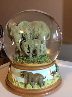 Music box elephant water globe by MoonwaterGems on Etsy:) This would be the PERFECT snowglobe for my Sugar Bear. He collects snowglobes and elephants