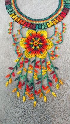 Stunning flower of yellow detailing. This is described as the rainfall because of the details in the beading having a cascading effect. Its gorgeous and very durable Bead Jewellery, Seed Bead Jewelry, Seed Beads, Beaded Jewelry, Native Beading Patterns, Beaded Crafts, Native American Beading, Peyote Stitch, Beaded Flowers