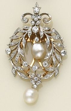 A diamond, pearl and platinum-topped gold clip-brooch the foliate wreath design clip brooch with floral and fleur-de-lys accents, set throughout with old European-cut diamonds, suspending two baroque pearls.