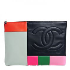 This is an authentic CHANEL Lambskin Patchwork Pouch in Multicolor. This chic extra-large clutch is designed of lambskin leather with a patch work design in multicolor.