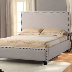 Features:  -Timeless and stylish addition to any bedroom décor.  -Headboard with nail head accent and matching nail head footboard.  -Nailhead color: Bronze.  -A box spring can be used.  Frame Materia