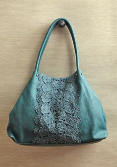 Jasmine Tote In Teal By Darling UK 78.99 at shopruche.com. Fit all your essentials and more in this gorgeous teal faux leather purse with dusty blue crocheted detailing. Finished with a double snap closure and gold-toned hardware.1 interior zipper...