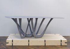 Zieta - Inflated steel table legs generated by a computer controlled parametric program