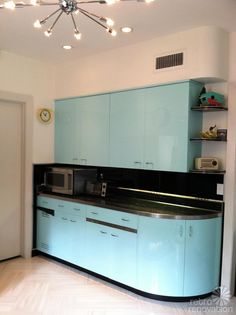 Painted with automotive paint. Beautiful. vintage-aqua-kitchen-steel-cabinets