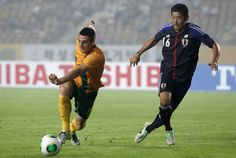 HWASEONG, SOUTH KOREA - JULY 25: Tomi Juric of Australia competes for the ball with Yuzo Kurihara of Japan during the EAFF East Asian Cup match between Japan and Australia at Hwaseong Stadium on July 25, 2013 in Hwaseong, South Korea.  http://www3.daylife.com/photo/0fzmfjD2rVcv7