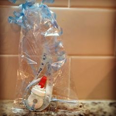 Baby shower favor: icing, life saver, and Mike and Ike! Love this!