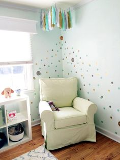Love the dot decals and tissue tassel garland in the glider corner of the nursery. Such fun accents!
