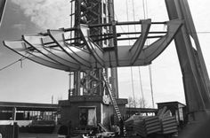 The first section of the Space Needle's fins around the top is lifted in this Oct. 28, 1961 photo. Photo: George Gulacsik/Seattle Public Library / 2016 Seattle Public Library