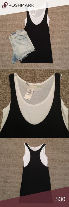 """Neiman Marcus Casual Tank Top Layered tank top. Black & white layers. Racer back. Can be worn together or separate. 12.5"""" across. 27"""" down. Made of 100% viscose. Purchased at Neiman Marcus. Smoke & pet free home. NM Tops Tank Tops"""
