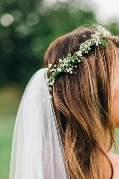 wedding hairstyle with flower crown veil