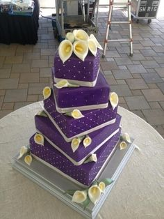 Purple Wedding Cake By GRAMMASUE on CakeCentral.com. The Callalillies are pretty easy in gum paste. Stacking the cakes might be a challenge.