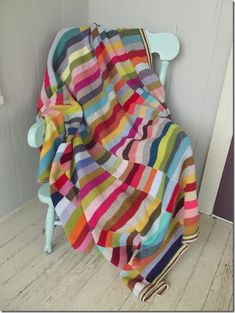Knit as long scarves and then mattress stitched together. Oh yes, perfect leftover yarn stash buster!