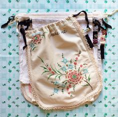 dottie angel: handy dandy project fruitiness. How sweet are these embroidered vintage linens, lovingly pieced and patched together to become handy dandy sacks for keeping sewing, yarn or other little projects and collections safe. Sadly no how-to or tutorial. #sew #Organise #CreativeProjects