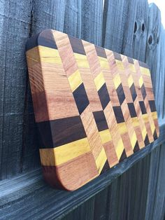 Cutting Board Solid wood used: Oak Wood Yellow Heart Black Walnut Jatoba wood Easy to hold and transport items from your kitchen to table with your fresh baked bead or exotic sliced cheese to accompany your wine. 18 L x 9 W x T End Grain Cutting Board, Diy Cutting Board, Wood Cutting Boards, Custom Woodworking, Woodworking Projects Plans, Bd Design, Beading Tools, Wood Creations, Wood Crafts