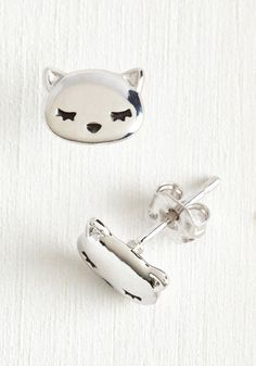 Even on a day spent lounging, you wouldn't dream of looking anything less than adorable! Enter these silver sleepy kitty studs - the cutest li'l pair for your cozy afternoon spent inside.