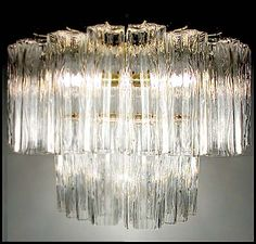 A spectacular 1960's Murano chandelier by Venini. Two tiers of textured glass (referred to as tronchi) provide the ultimate in vintage glam lighting. Image © Eclectisaurus. Visit our shop at 249 Gerrard St E, Toronto. 416-934-9009 www.eclectisaurus.com