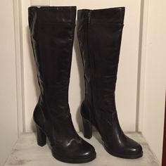 "Never Worn!!! black leather knee high boots BLACK knee high leather boots. NWOT, NEVER WORN. perfect condition. just under 4"" heel. from bottom of heel (at the back) to the top is 18""  circumference opening approx. 16"" size 38 I'm a 7.5 and these fit perfectly. Reasonable offers considered ALDO Shoes Heeled Boots"